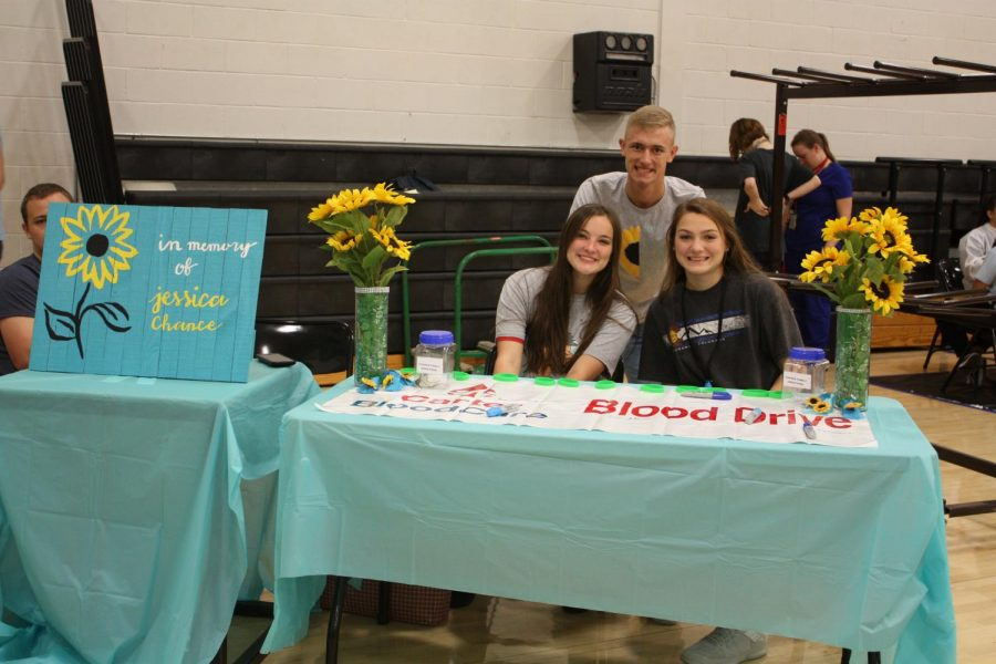 Here+are+Seniors+Killian+Mcdonald-+Boyer%2C+Allison+Roecker+and+Reed+Ludwig+running+the+booth+at+the+blood+drive.+