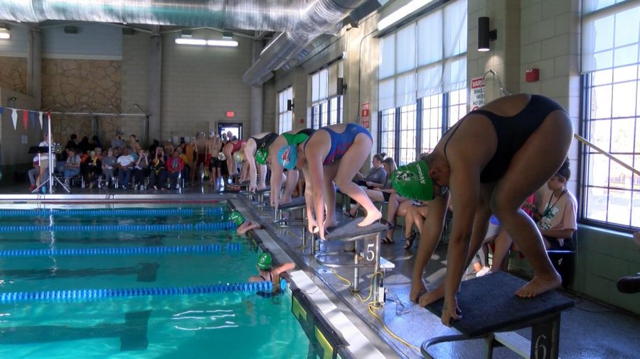 Swim Team Races Their Way To District