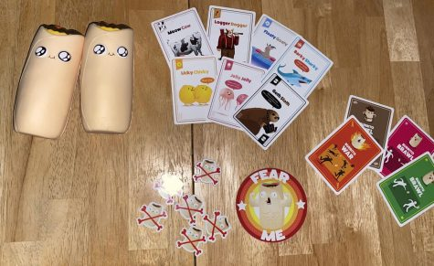 This photo shows all the game pieces a part of the card game.