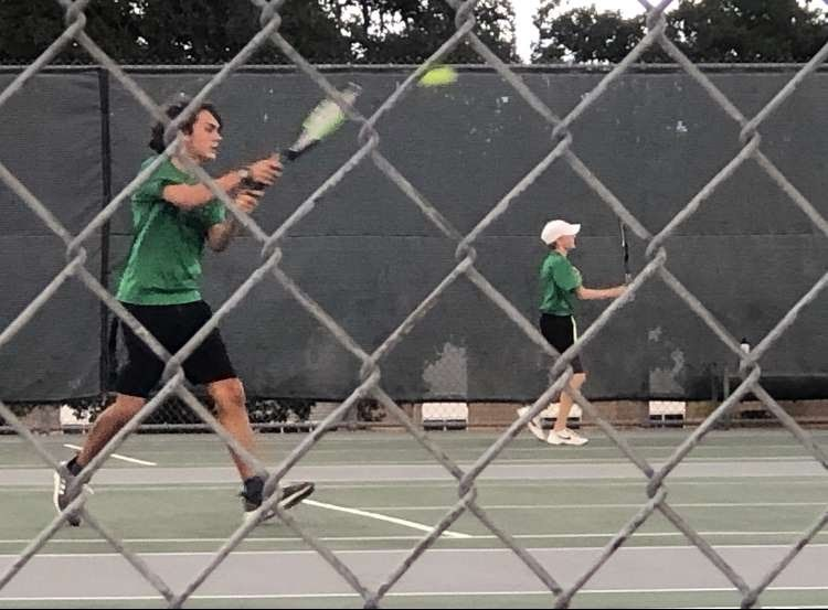 Sophomore Jett Lee returns a serve during a practice match.