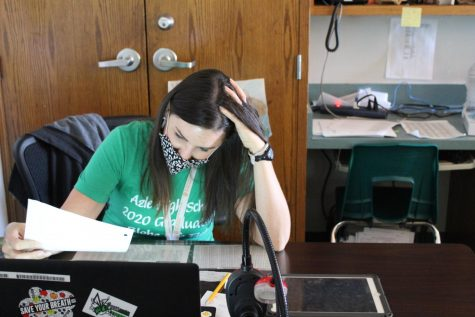Math teacher Rachel Bevan working with virtual and in-person students simultaneously.