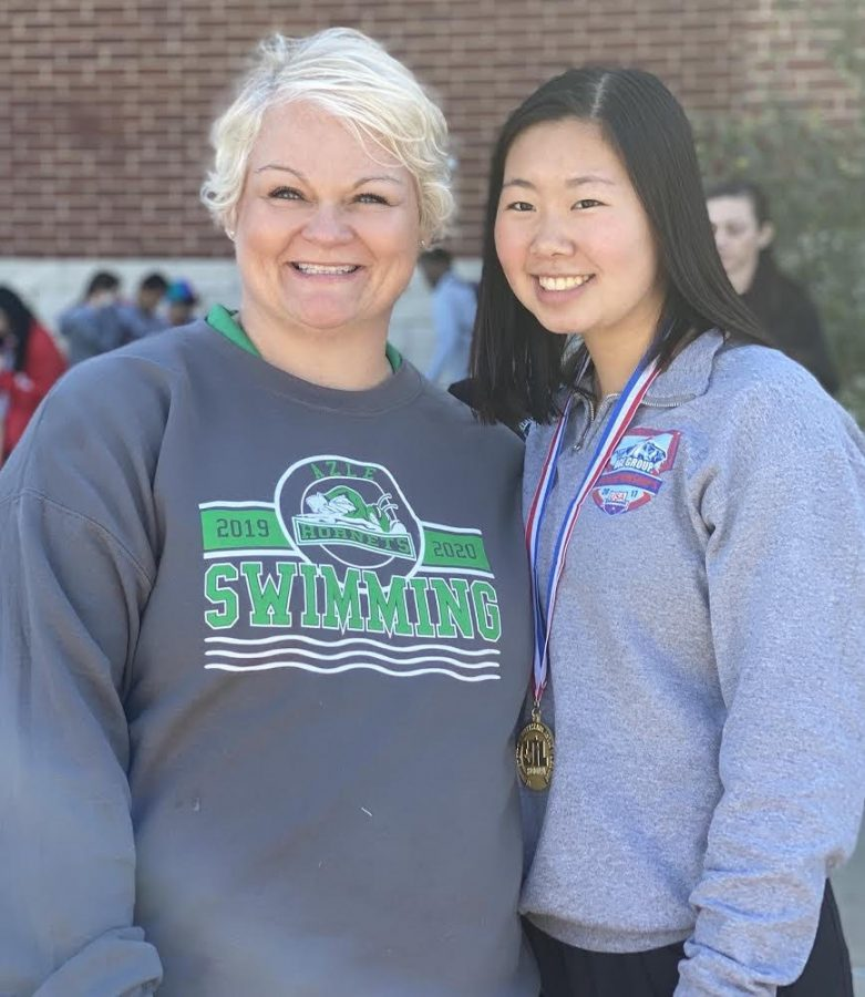 Coach Estes with sophomore Phoebe Mosley at the regional meet last February.