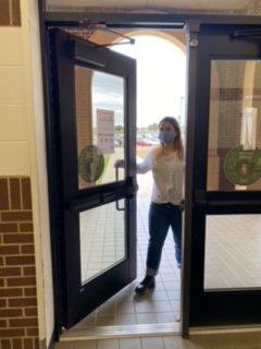 Maryann Matt opening up the doors to the school.