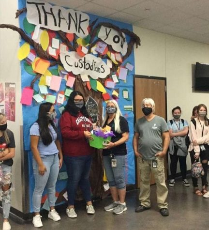 FCCLA presents head custodian Roxanne Hampton and the rest of the custodial staff with a gift for their hard work.