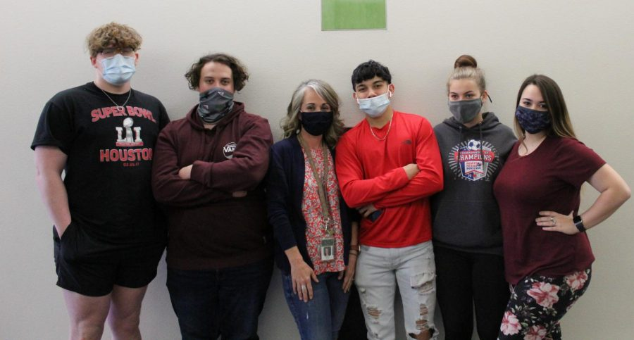 Ms. Hutton hangs out with her 3rd period students, (left to right) senior Ashton Morgan, senior Anthony Medovich, senior Johann Lopez, junior Jasmine Gaither and senior Erica Horning.
