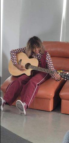 Ashley playing guitar.