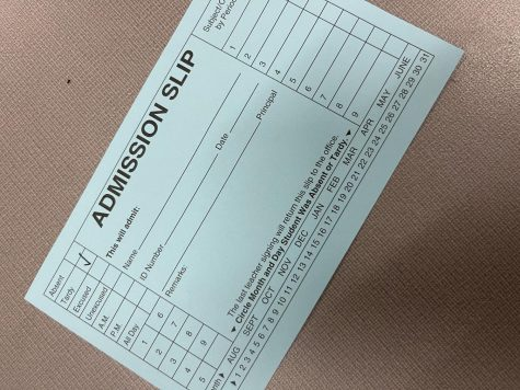 Admission slip marked for a tardy.