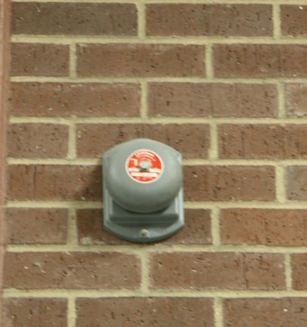 A picture of a bell within the school