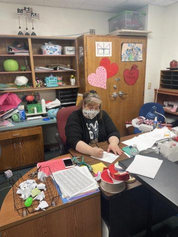 Ms. Marlett working at her desk.