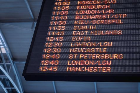 A board displays the arrivals and departures for flights.