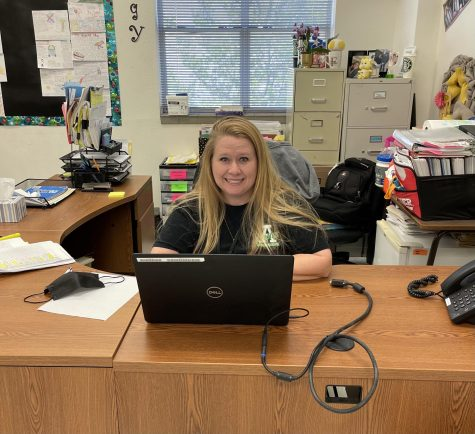 Mrs. Fuller working behind her desk.