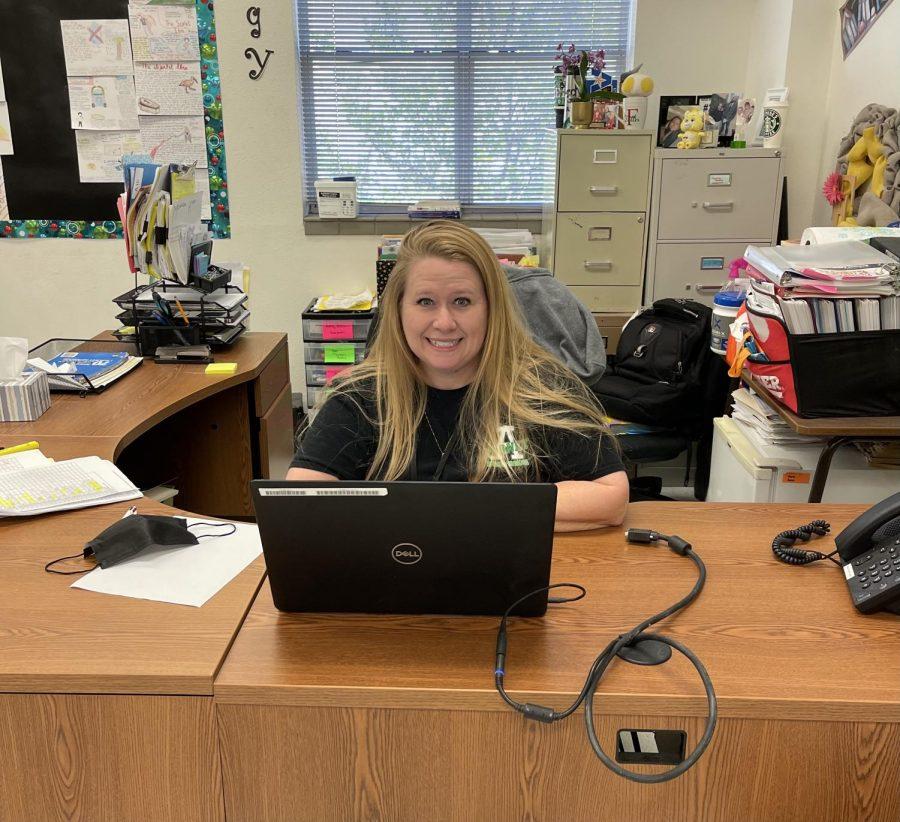 Mrs.+Fuller+working+behind+her+desk.