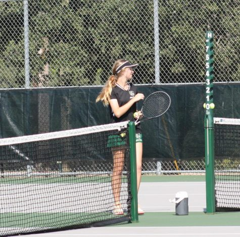 New Tennis Coach Swings into Play