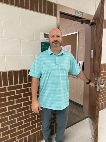 Coach Ball standing outside of his classroom.