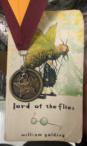 The Lord of the Flies book with a medal.